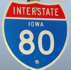 Blue and red Interstate 80 sign.