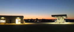 Dusk, orange sunset over car wash and gas station pumps