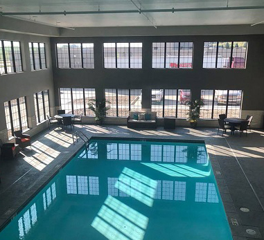 Blue Grass Inn & Suites indoor pool with glass windows surrounding two sides