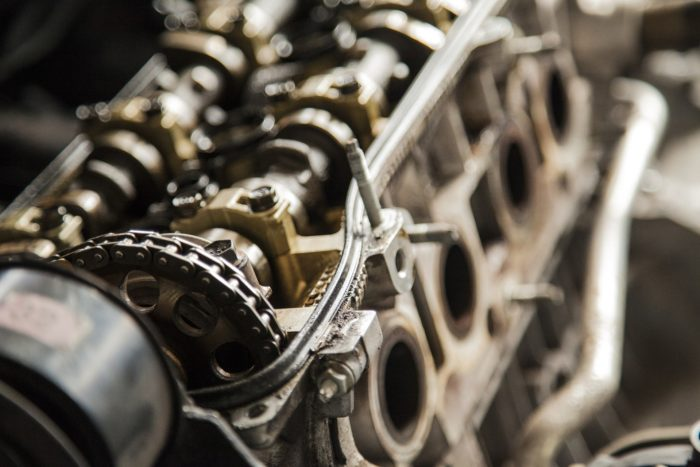 Close up of a motor with gears and pistons.