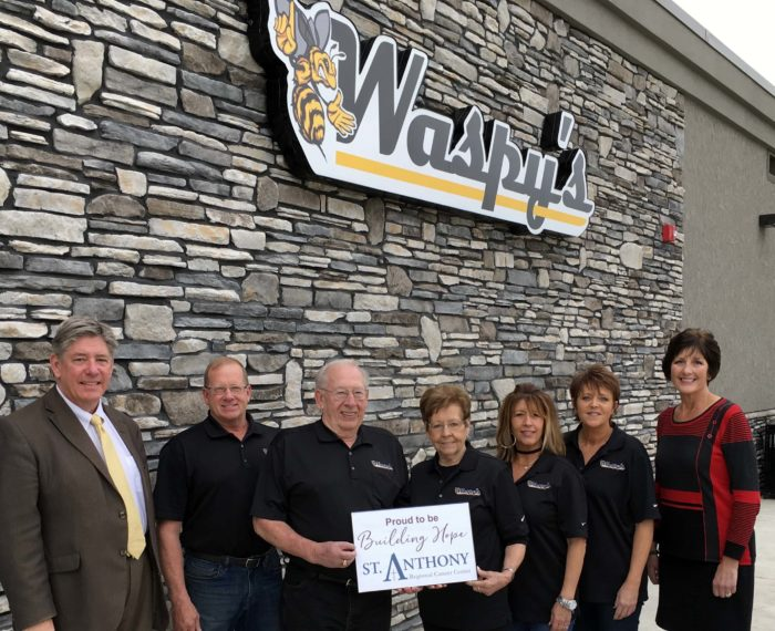 Waspy's owners and family donating to the St. Anthony Regional Cancer Center