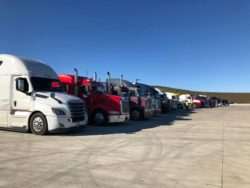 Line of semi trucks parked in the Waspy's parking lot