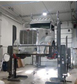 Semi truck on a lift at Audubon Diesel