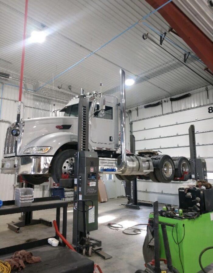 diesel mechanics working on semi-truck at Audubon Diesel